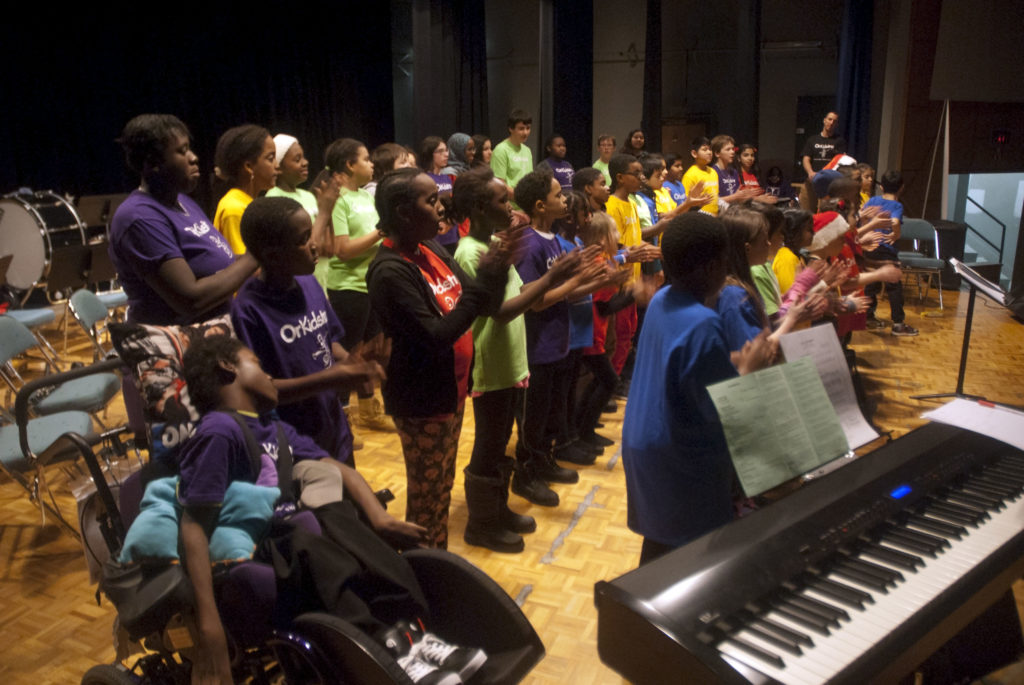 A group of children singing in a choir