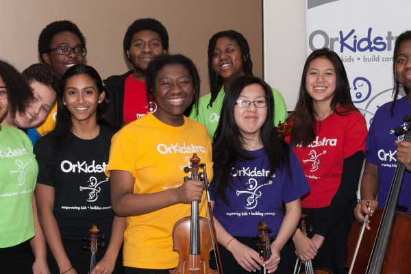 OrKidstra students smiling with instruments