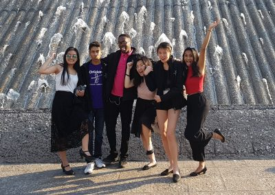 Six OrKidstra students having fun in front of a fountain in Mexico City