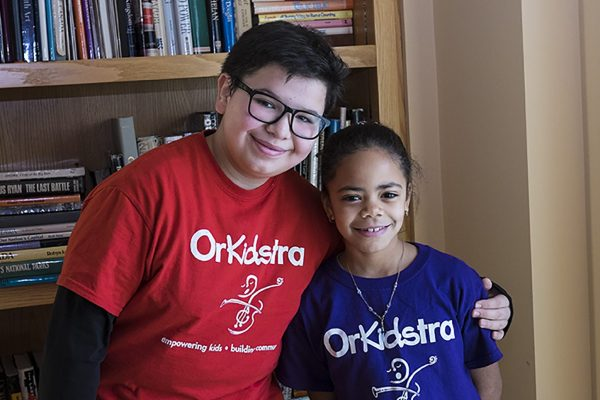A photo of two OrKidstra students